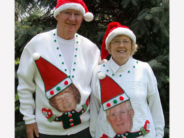Couple wearing matching Christmas sweaters